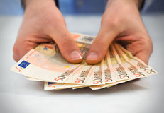 Man handling money. Royalty Free Stock Image