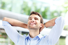 Man with hands behind his head, relaxing Royalty Free Stock Image