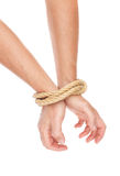 The man hands bound with a rope. Stock Image