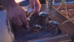 Hands brewed traditional coffee in sand on the turkish street. stock video footage