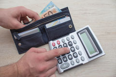 Man, Hands calculator to count money Royalty Free Stock Photography