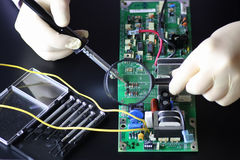 Man hands chip soldering tools Royalty Free Stock Image