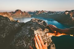 Man hands climbing up to mountain summit royalty free stock image