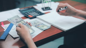 Man hands counting profit, working with budget, using calculator. US dollars. stock video