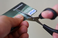 Man hands cut creditcard with scissors Stock Image