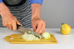 Man hands cutting onion Royalty Free Stock Images