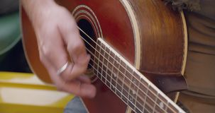 Man hands detail playing guitar music.Caucasian couple in love roadtrip vacation italian travel on convertible vintage. Car.4k handheld video stock video footage