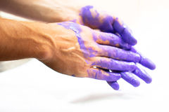 Man hands dirty by purple paint as decoration, housework, painte Royalty Free Stock Photos