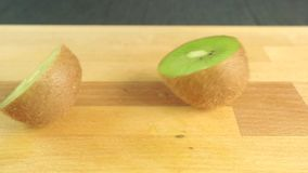 Man hands dividing kiwi with white knife stock video footage