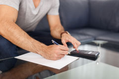 Man hands doing calculation Royalty Free Stock Images