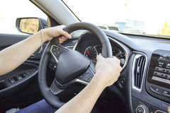 Man with hands on driving wheel. In car Stock Photo
