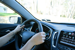 Man with hands on driving wheel. In car Stock Photos