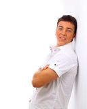 Man with hands folded isolated on white background. Portrait of young man with hands folded isolated on white background royalty free stock photo
