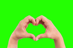 Man hands in the form of heart against the chroma key green screen background, hands in shape of love Royalty Free Stock Photo