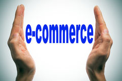 E-commerce. Man hands forming brackets and the word e-commerce written between them Royalty Free Stock Photo