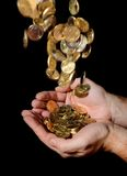 Man Hands full of money receiving a Rain of Coins Royalty Free Stock Photos