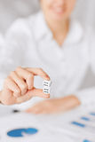 Man hands with gambling dices signing contract Royalty Free Stock Images