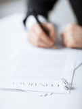 Man hands with gambling dices signing contract Stock Photography