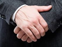 Man hands gesture protection defence insecurity. Man hands clenched in front. gesture of protection defence and insecurity. holding oneself by the hand stock photos
