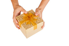 Man hands give golden gift box Stock Photo