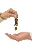 Man hands giving keys to woman Stock Photos