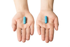 Man hands giving two big blue pills. Make your choice. Calm nerves consept Stock Images