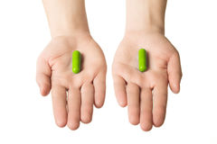 Man hands giving two big blue pills. Make your choice of healthcare. Herbal consept. Stock Image