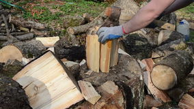Man hands with gloves chopping wood with axe stock video