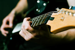 Man hands on guitar Royalty Free Stock Images
