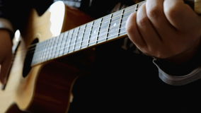 Man hands the guitar. The young man at home holding a guitar and play music stock footage