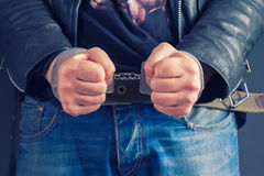 Man hands in handcuffs Royalty Free Stock Image