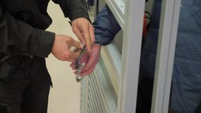 Man hands in handcuffs. Cop taking off handcuffs on a suspect stock footage
