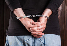 Man hands in handcuffs Royalty Free Stock Photography