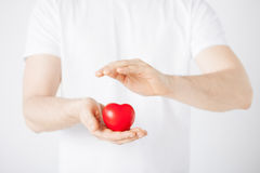 Man hands with heart Stock Images