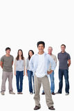 Man with hands on his hip and friends behind him Royalty Free Stock Photos