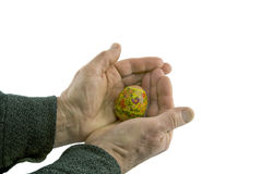 Man hands hold decorated easter egg. Isolated over white background Royalty Free Stock Images