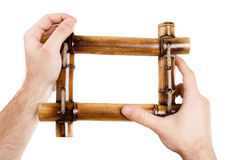 Man hands holding bamboo frame Stock Photography