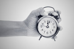 Free Man Hands Holding Big Round Clock Royalty Free Stock Images - 81080629