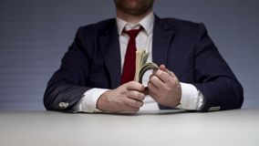 Man hands holding bundle of money. Monetary profit successful businessman. Man hands holding bundle of money. Successful manager received an increase in salary stock video footage