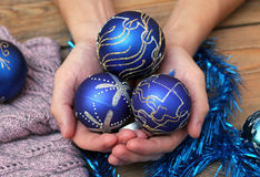 Man hands holding christmas balls Stock Photos