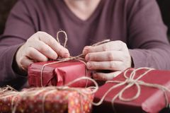 Man hands holding christmas holiday gift box on decorated festive table Stock Images