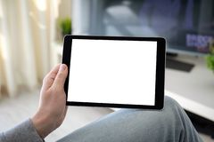 Man hands holding computer tablet with  screen in room. Man hands holding computer tablet with  screen in the home room stock photo