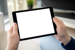 Man hands holding computer tablet with  screen in room. Man hands holding computer tablet with  screen in the home room royalty free stock photos