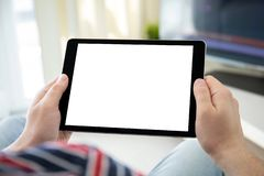 Man hands holding computer tablet with isolated screen in room. Man hands holding computer tablet with isolated screen in the home room royalty free stock photo
