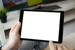Man hands holding computer tablet with isolated screen in room. Man hands holding computer tablet with isolated screen in the home room stock images
