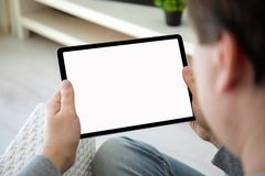 Man hands holding computer tablet with  screen in room royalty free stock photos