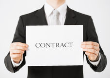 Man hands holding contract paper Royalty Free Stock Photo