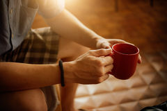 Man hands holding cup of coffee Royalty Free Stock Image