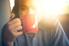 Man hands holding cup of coffee Stock Photos