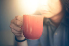 Man hands holding cup of coffee Stock Image